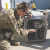 Partnerships with government agencies, including local law officials, often require a written agreement. Here, Emily King, a helicopter pilot with the Colorado Army National Guard, checks out a Texas shelter dog slated for transport to New Jersey.