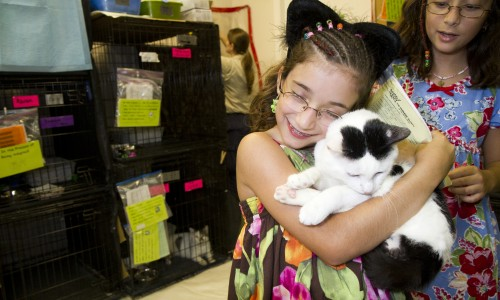 Humane educators have a chance to reach kids with multiple animal-friendly messages, including the one about shelter adoptions. Sisters Karla and Teresa McNiece found Biggles at a cat adopt-a-thon in Florida.
