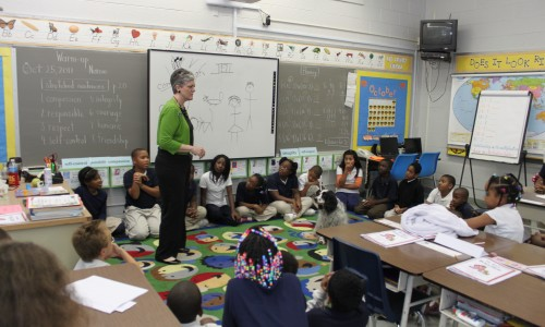"""Jo Dean Hearn of Wayside Waifs presents a lesson from her """"No MoreBullies!"""" curriculum to third-graders in Kansas City, Mo. She often brings Wally, her English cocker spaniel, to help children connect with her message of kindness toward humans and animals."""