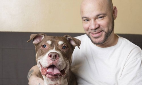 foster parent with adoptable dog